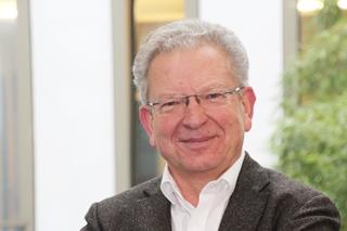 Dr. Uwe Kremer